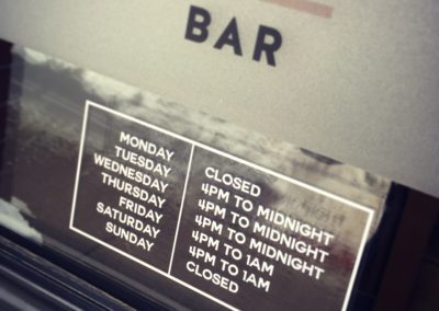 Let them know when you're open with custom business hours vinyl lettering.